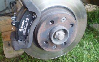 Замена передних тормозных дисков на Рено Логан
